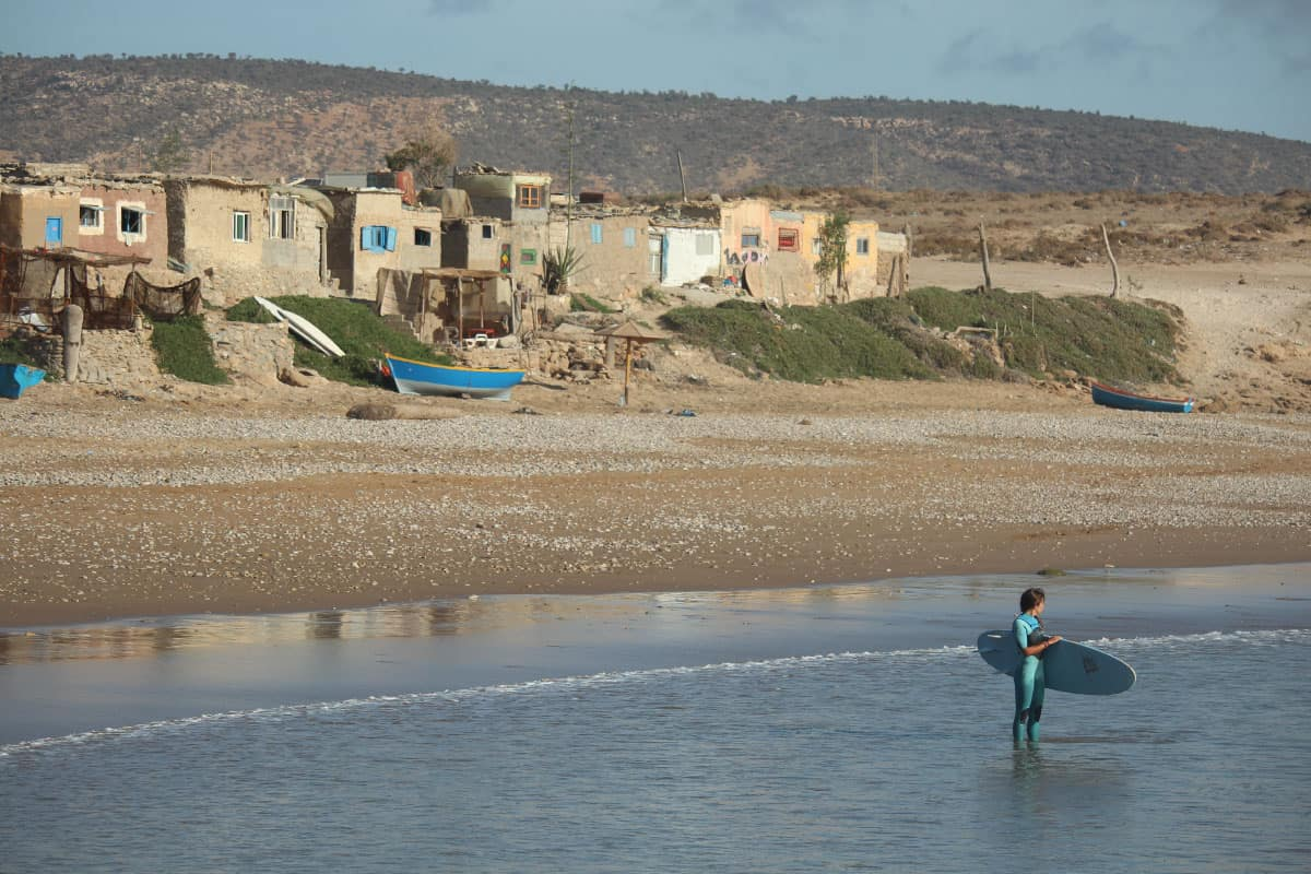 girl preparing to surfing in village