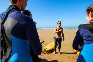 surf lessons talk in blue waves
